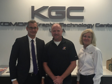 Standing, from left to right: Clark Scherer, Komori district sales manager; Rod Stoffel, president and owner of JP Graphics, and Jacki Hudmon, senior VP, business development for Komori America.