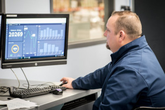 Toby McManus, director of business development at Superior, checks the Site Flow dashboard.