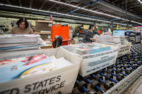 Thousands of cookbooks are processed for shipping.