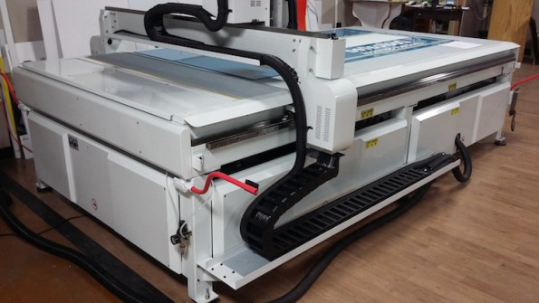 Just-Us Printers uses its Colex SharpCut digital flatbed cutter, pictured above in their shop, as an essential piece of the print provider's wide-format ecosystem.