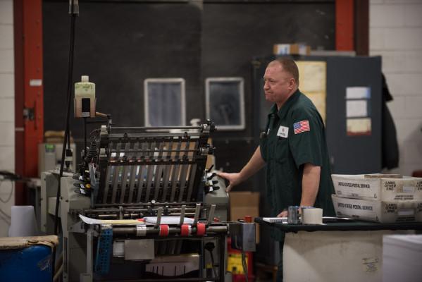 Scott Henery operates a Stahl folding machine in the bindery.
