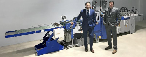 Solo Printing's Vice President of Sales Robert Hernandez (left); and Vice President of Operations, Jorge Hernandez, Jr., stand next to the company's new BSR 550 Servo Rotary Die Cutter from MBO.