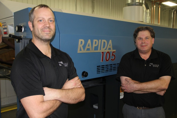 Two press operators at Royle Printing eagerly anticipate the new KBA Rapida 105 press being installed at the firm's Sun Prairie, Wis., facility.