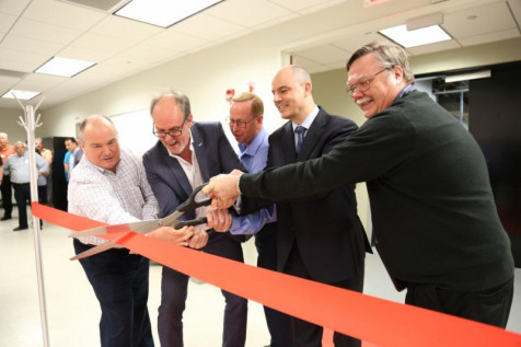 Ribbon-cutting ceremony at Agfa Graphics' new Offset Technical Competence Center. Pictured (L-R) are: Dave Carey, Sr. Product Marketing Manager; Guido Hauquier, HQ Director, Application and Service, Prepress; Tim Cornelius, Director, U.S. Prepress Sales; Gunther Mertens, President, North America Region; Fred Marland, HQ Sr. Applications Product Manager.