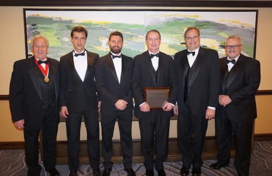 INX International officials celebrate Dave Waller's NAPIM Ink Pioneer Award.