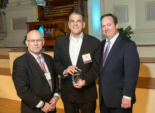 Guy Gecht (center), CEO of EFI, was presented with the PINE Industry Influencer Award.