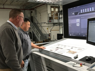Greg Moquin, president and owner, together with the company's XL 106 press operator at Moquin Press.