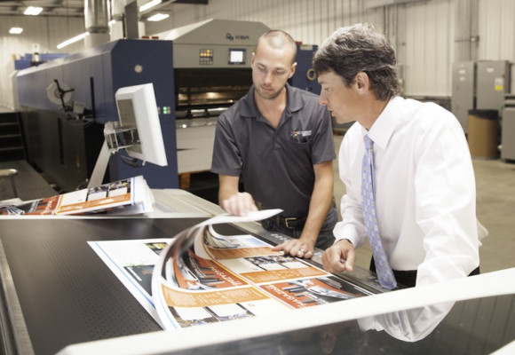 Thomas Coley and Doug Hederman (right), president and CEO, discuss curing and color quality that's capable with LED-UV sheetfed offset printing.