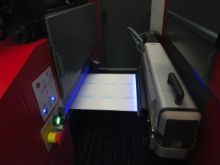 An IST Metz LED UV curing unit (right) at work on a Codimag label press.
