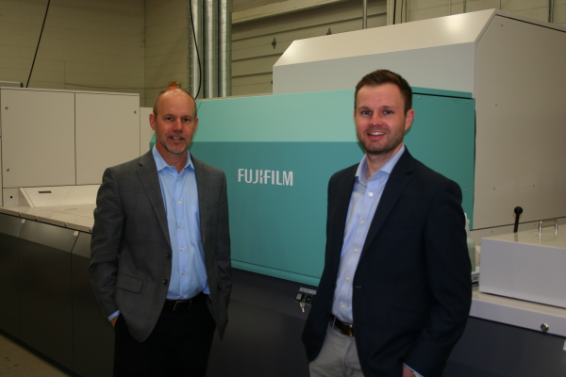 Todd Meissner, left, president, Color Ink, proudly stands next to the J Press 720S, along with his son, Austin, Sales and Sourcing Manager, at their Sussex, Wisc. facility.