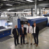 From left to right: Sam Creel, KBA sales manager; Doug Hederman, CEO and president of Hederman Brothers; John Shaw, printing manager at Hederman Brothers; and Chris Travis, KBA director of technology, attend the open house.