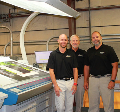 From left to right: The management team at J.W. Moore: Matt Moore, Gary Moore, and Michael Moore, eagerly await their new KBA Rapida 145 sheetfed press plus coater.