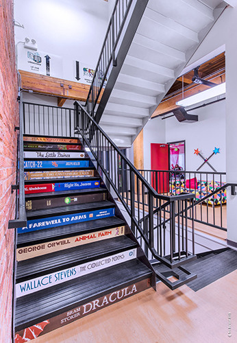 These eye-catching book spine stairs were created and installed by Cushing connect the main spaces. Photo by Tim Benson.