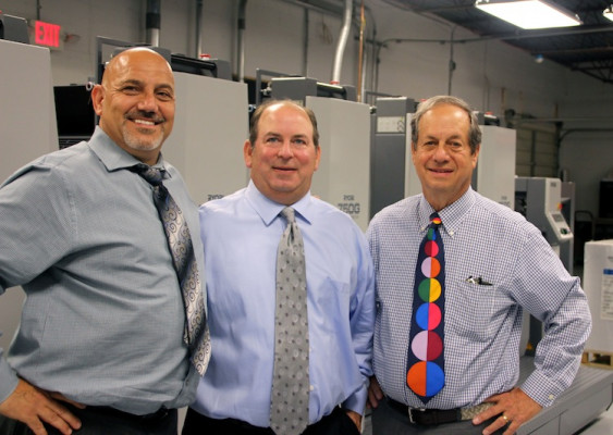From the left, are partners Carl Piccari, Jim Rosenthal and John Rosenthal, standing in front of the new Ryobi 750G offset press.