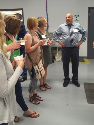 Carl Piccari talks with several customers and takes them on a tour of the pressroom.