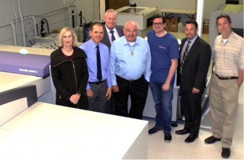 From left to right are Maria Guerrero, FG operations manager; Kirk Folger, VP of sales, Matt Mahoney, Fuji sales manager; Dick Folger, FG president; Matthew Revak, FG prepress manager; Dennis Siegrist, Fuji western regional sales director; and Tom Jansen, FG general manager.