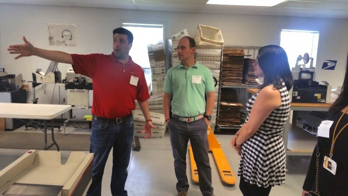 Jeff Rosenthal, John Rosenthal's son and mailing expert, takes customers on a tour of the company's mailing and fulfillment area.