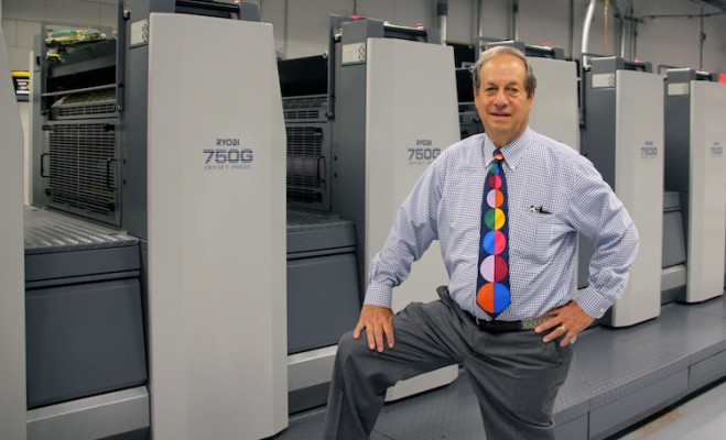 John Rosenthal stands next to the six-color Ryobi 750G offset press with coater that Paradigm Digital Color Graphics installed last year.