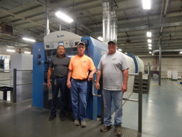 Southern Champion Tray's pressroom manager John Moreno (left) joins press operators Keith Miller (center) and Pat Osier (right) near their LED-UV equipped Rapida 106, which was retrofit with an AMS Spectral UV - A Baldwin Technology Company system in September 2016.