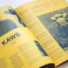 A sample of a featured article. An interview with KAWS by Brian Flynn. A peek inside a career oscillating between street art, limited-run figurines and large scale sculptural work. (Pages 10-11)