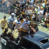 Penguins players greet fans during their Stanley Cup parade in Pittsburgh.