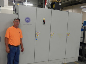 Here, press operator Keith Miller stands near the power and control cabinets for Southern Champion Tray's LED-UV curing system installed on its KBA Rapida 106 press.