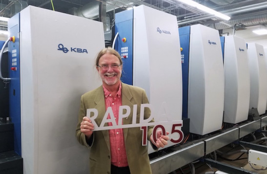 Bolger CEO dik Bolger is all smiles in front of his new KBA Rapida 105 six-color press with UV and full automation