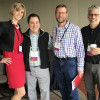 Young Innovators Conference founder Sarah Scudder stands with attendees at the fourth annual conference in Denver.