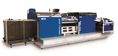 This high-speed, high pile stacker from MBO minimizes the dead time of a production line by stacking large sheets directly onto the pallet. Once a pallet batch count is fulfilled, the SHP automatically ejects the finished stack. The incoming sheets become a shingled stream and are transported along a lengthwise alignment system in order to form a perfect stack. During a pallet change, the SSC Separation Module will collect the sheets and create a gap between the stream and the pallet to enable full speed production. With the aid of special vacuum overguides even very long sheets can be stacked neatly and accurate.