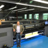 Excelsus Solutions CEO and President of Décor Brilliance, Mark Laniak, pictured with the HP Latex 3500.