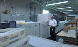Alan Olivero, founder and president, Matrix Imaging Solutions, stands alongside his company's new Xerox Brenva HD Production Inkjet Press.