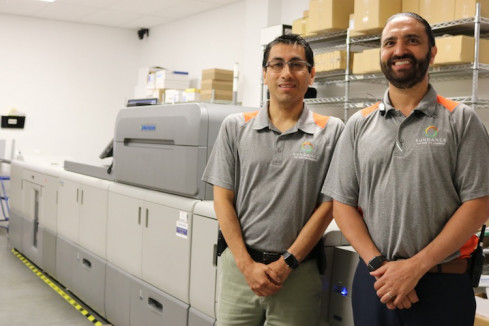 From left: Cris Bucheli and JohnHenry Ruggieri of SunDance Marketing Solutions stand next to the company's new Versafire CP digital press from Heidelberg.