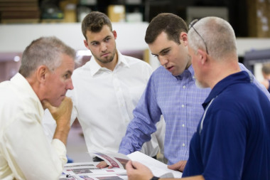All Color Printers: From left, Billy, Will and Steven Bogue confer about a job with one of All Color's employees.