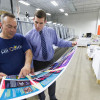 All Color Printers: Steven Bogue (right) discusses color quality for a job being run on All Color's six-color, 41˝ Heidelberg XL 106 with Push to Stop technology.