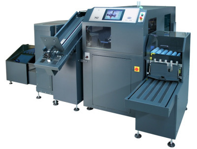 The 330TC three-knife book trimmer fully automated system for on-demand, perfect-bound book trimming from The Challenge Machinery Co.
