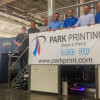 """Standing with their six-color, 64"""" KBA Rapida 162 sheetfed offset press retrofitted with LED-UV systems from IST America are, from the left, Mike Sampson, Walt Mastey, Jeff Gray, Mike Koloski, Brian Koloski, Tim Koloski and Keith Kuebelbeck."""