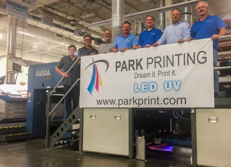 "Standing with their six-color, 64"" KBA Rapida 162 sheetfed offset press retrofitted with LED-UV systems from IST America are, from the left, Mike Sampson, Walt Mastey, Jeff Gray, Mike Koloski, Brian Koloski, Tim Koloski and Keith Kuebelbeck."