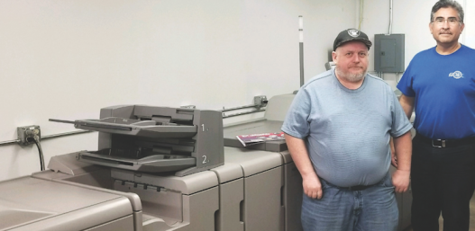 Frank Pena and Scott Gibson of Valley Printing stand next to their Versafire CV.