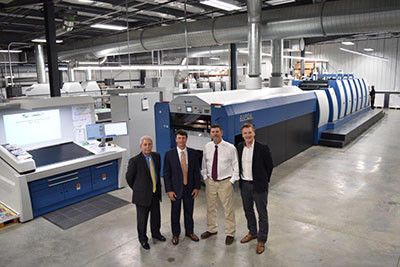 Left to right: Sam Creel, KBA Sales Manager; Doug Hederman, CEO and President of Hederman Brothers; John Shaw, printing manager at Hederman Brothers; and Chris Travis, KBA Director of Technology, attend the open house.