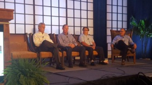 From left, Ray Mass of Colgate Palmolive, Calvin Osterberg of Rochester Midland Corp., and Patrick Poitevin of Mondelez, discuss digital printing with Kevin Karstedt of Karstedt Partners.