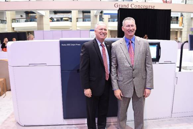 From left to right: Xerox CEO Jeff Jacobson and Kurt Smallhoover, president and CEO, Pittsburgh Mailing, stand in front of the Xerox Rialto 900 inkjet press.