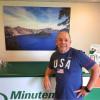 Steven Dunn poses at his Minuteman Press franchise in Beaverton, Ore.