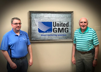 Scott Hayner, the owner of United Graphics & Mailing Group, stands with his father John Hayner, who was a VP and served in customer service and sales throughout his career at the company. He still enjoys working in the bindery cutting and folding, when he is in town.