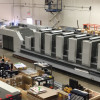 The six-color Komori Lithrone G40, equipped with coater (GL640C), on the Dreamworks' production floor.