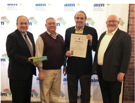 Rick Lord, AIM President, presents the Sustainability and Environmental Leadership award to John Galligan, president; Rick Dunn, executive EVP; and Fred Doherty, B&B energy consultant.