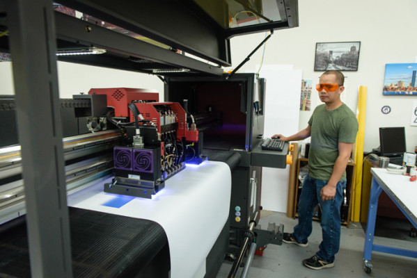 Tuan Phan, print production manager, operates a 64˝ EFI Hi625 LED wide-format printer that was installed last year to produce point-of-sale materials, banners, yard signs and other complementary product offerings.