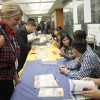 Future Authors Project: Students sign books at the book signing that was held this fall at the Jericho High School.