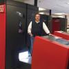Jon Kaufman, SVP, technical development, stands next to one of Allied Printing Services new Xeikon 9800 digital presses.
