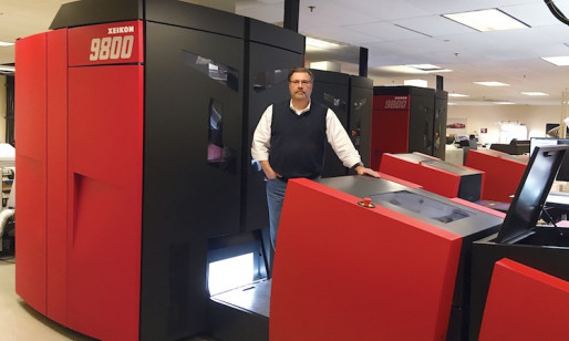 Jon Kaufman, SVP, technical development, stands next to one of Allied Printing Services new Xeikon 9800 digital presses.