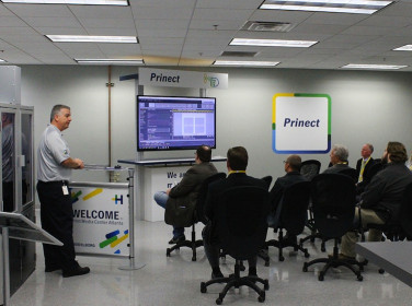 Sean White, prepress demonstrator, highlights the capabilities of Prinect workflow.
